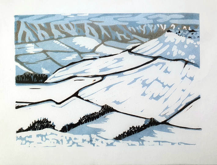 Edges, by Lyn Bailey. A print showing snowy fields with drystone walls and hedges.
